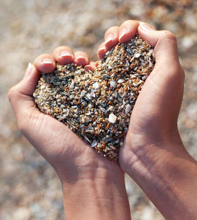 Photo for Hands holding a sand in form of the heart - Royalty Free Image
