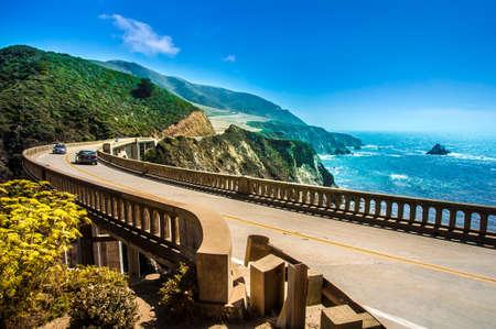 Foto de Bixby Creek Bridge on Highway  1 at the US West Coast traveling south to Los Angeles, Big Sur Area - Picture made during a motorcycle road trip - Imagen libre de derechos