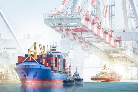 Photo pour Logistics import export background and transportation industry of international container cargo ship with tugboat on port crane background - image libre de droit