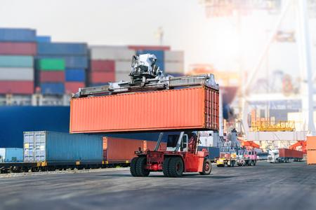 Foto de Logistics import export background and transport industry of forklift handling container box loading at port - Imagen libre de derechos