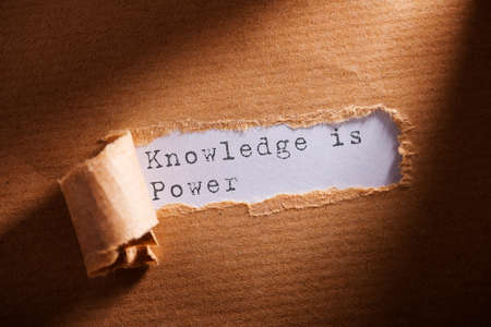 Photo for torn paper with word Knowledge is power - Royalty Free Image