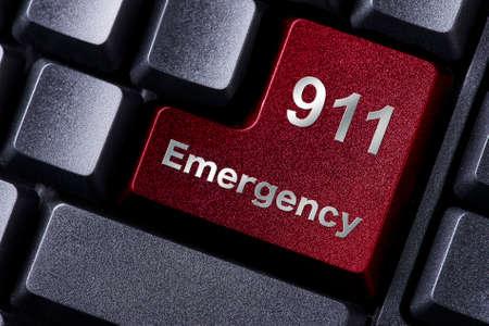 Foto de close up red enter button written emergency - Imagen libre de derechos