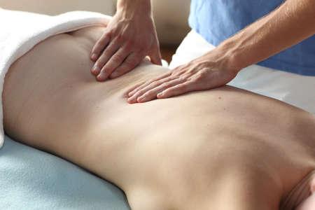 female receiving back massage - close up