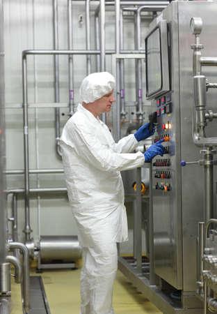 Foto de biotechnology technician controlling industrial process - Imagen libre de derechos