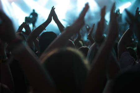 Photo for clapping crowd at the concert, rear view - Royalty Free Image
