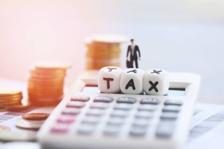 Photo pour Tax concept and calculator stacked coins on invoice bill paper for time tax filling paid debt payment at office Businessman finances - image libre de droit