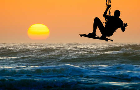 kite boarder in action and sunset