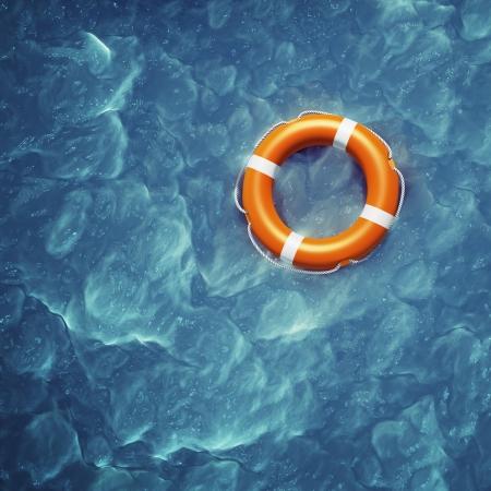 Foto de Lifebuoy in a stormy blue sea - Imagen libre de derechos