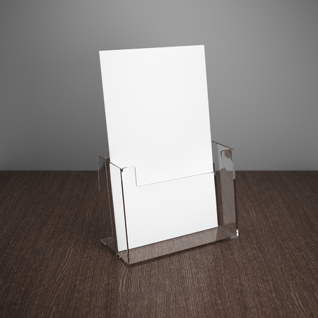 Photo pour Blank brochure with glass holder on wooden table - image libre de droit