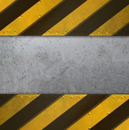 Foto de Metal plate with caution stripes - Imagen libre de derechos
