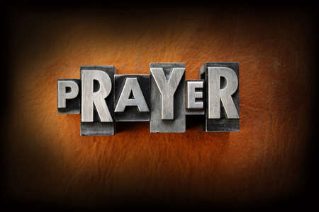 Photo pour The word prayer made from vintage lead letterpress type on a leather background. - image libre de droit