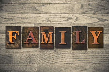 Foto de The word FAMILY written in wooden letterpress type. - Imagen libre de derechos