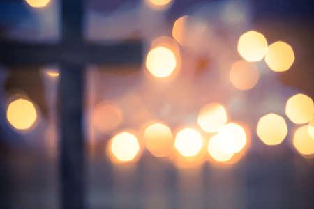 Photo pour A wooden Christian cross with a soft bokeh lights background. - image libre de droit