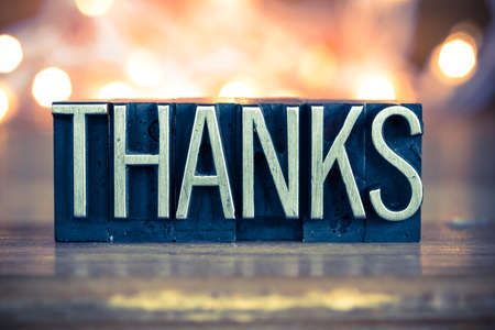 Foto für The word THANKS written in vintage metal letterpress type on a soft backlit background. - Lizenzfreies Bild