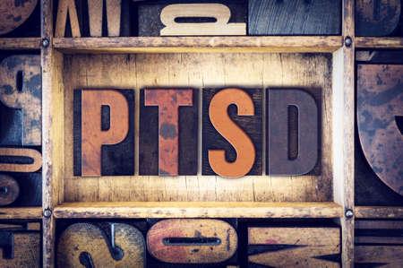 Foto de The word PTSD written in vintage wooden letterpress type. - Imagen libre de derechos