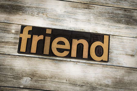 Photo pour The word friend written in wooden letterpress type on a white washed old wooden boards background. - image libre de droit