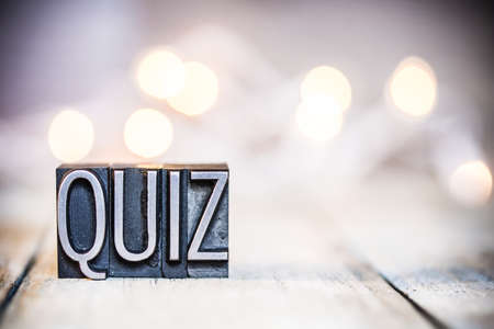 Photo for The word QUIZ written in vintage metal letterpress type on a bokeh light and wooden background. - Royalty Free Image