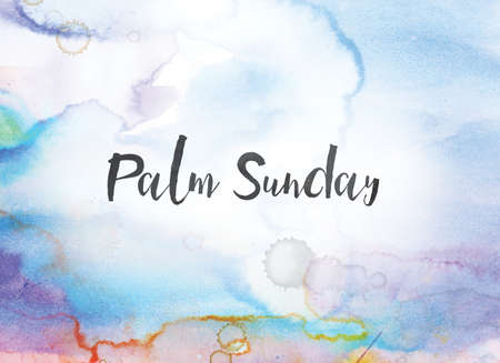 Photo for The words Palm Sunday concept and theme written in black ink on a colorful painted watercolor background. - Royalty Free Image