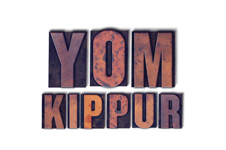 Photo for The words Yom Kippur concept and theme written in vintage wooden letterpress type on a white background. - Royalty Free Image