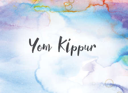 Photo for The words Yom Kippur concept and theme written in black ink on a colorful painted watercolor background. - Royalty Free Image