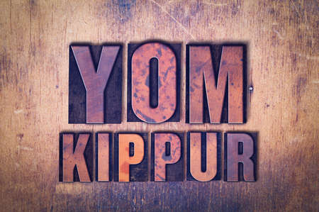 Photo for The words Yom Kippur concept and theme written in vintage wooden letterpress type on a grunge background. - Royalty Free Image