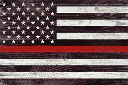 Photo pour A firefighter support flag painted on white washed wood grained boards. - image libre de droit