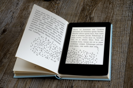 Foto de modern ebook reader on book on wooden background - Imagen libre de derechos