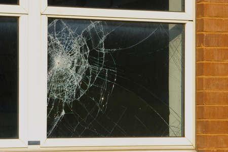 Foto de Crime scene - close up of a broken window - Imagen libre de derechos