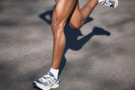 Photo pour Athlete running in a long distance race - image libre de droit