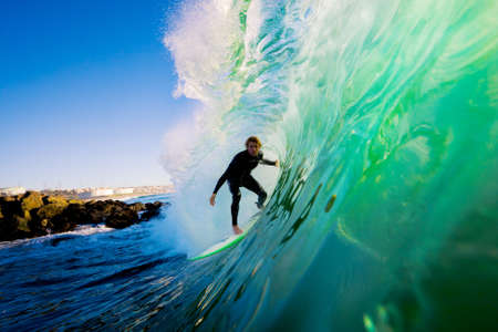 Photo pour Surfer on Blue Ocean Wave - image libre de droit