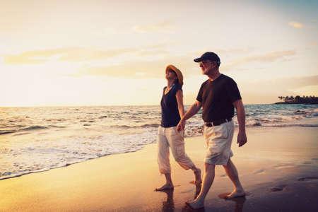 Photo pour Senior Couple Enjoying Sunset at the Beach - image libre de droit