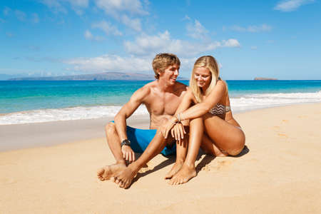 Photo for Attractive Young Couple on Tropical Beach - Royalty Free Image