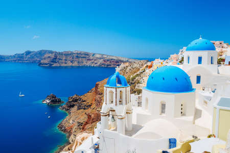 Photo for Santorini Island, Greece, Beautiful View of Blue Ocean and Traditional Dome Church Architecture  - Royalty Free Image
