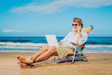 Photo for Young Business Man Working Remotely on Tropical Beach - Royalty Free Image