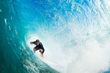 Foto de Surfer on Blue Ocean Wave in the Tube Getting Barreled - Imagen libre de derechos
