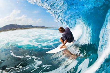 Photo pour Surfer on Blue Ocean Wave in the Tube Getting Barreled - image libre de droit