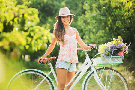 Foto de Beautiful Girl on Bike in Countryside, Summer Lifestyle  - Imagen libre de derechos