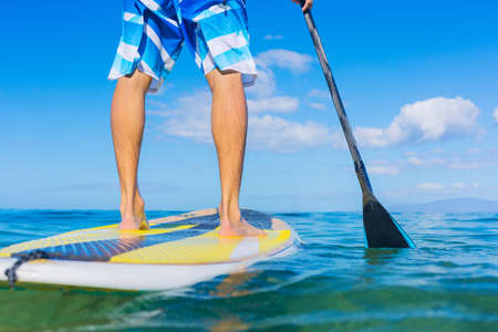 Photo for Attractive Young Man Stand Up Paddle Surfing In Hawaii, Beautiful Tropical Ocean, Active Beach Lifestyle - Royalty Free Image