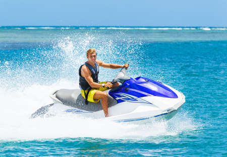 Photo for Young Man on Jet Ski, Tropical Ocean, Vacation Concept - Royalty Free Image