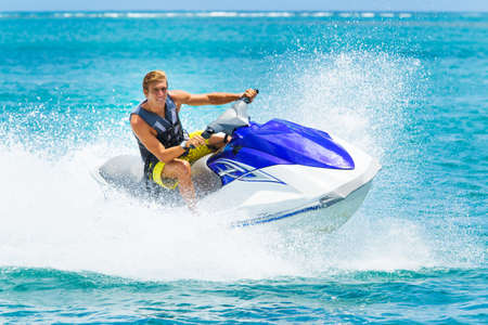 Foto de Young Man on Jet Ski, Tropical Ocean, Vacation Concept - Imagen libre de derechos