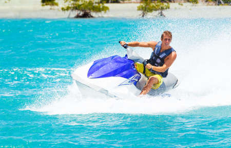 Foto de Man on Jet Ski having fun in Ocean - Imagen libre de derechos