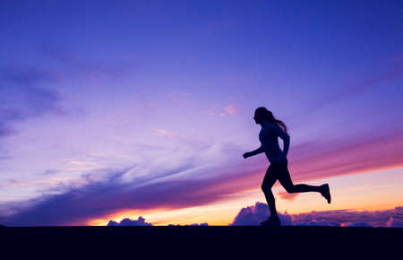 Photo for Female Runner Silhouette, Woman Running into sunset, colorful sunset sky - Royalty Free Image