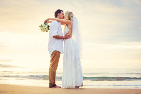 Photo pour Bride and Groom Watching Sunset on Beautiful Tropical Beach, Romantic Married Couple - image libre de droit