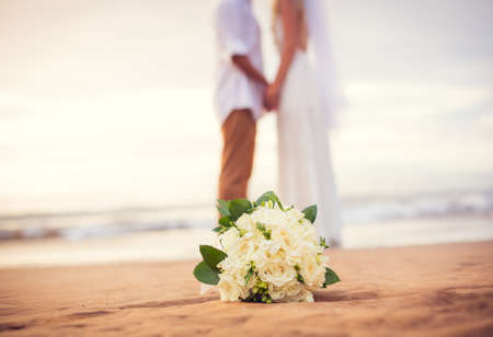 Foto de Just married couple holding hands on the beach, Hawaii Beach Wedding - Imagen libre de derechos