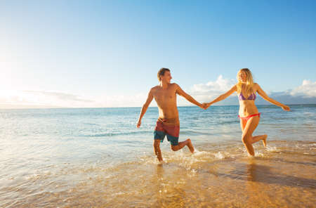 Photo for Happy Couple Running on Tropical Beach at Sunset, Vacation  - Royalty Free Image