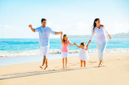 Photo for Family having fun on the beach - Royalty Free Image