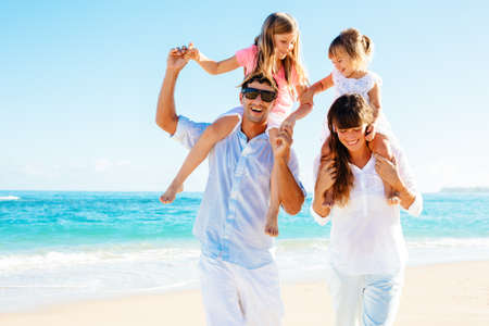 Photo for Happy family having fun on the beach - Royalty Free Image