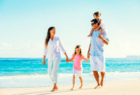 Photo for Happy Family Having Fun Walking on Tropical Beach - Royalty Free Image