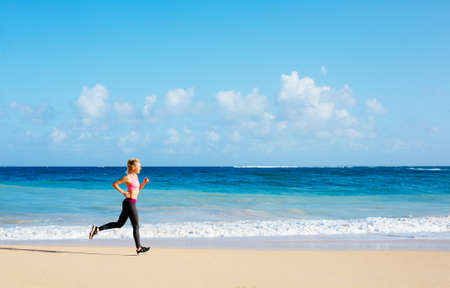 Photo pour Athletic Fitness Woman Running on the Beach. Female Runner Jogging. Outdoor Workout. Fitness Concept. - image libre de droit