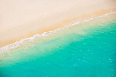 Foto de Beach and Sea. Aerial view from helicopter of tropical ocean meeting the sand - Imagen libre de derechos